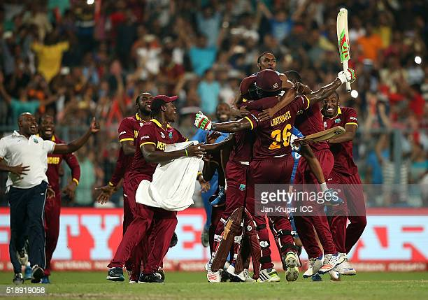 Carlos Brathwaite of the West Indies celebrate the winning runs with team mates during the ICC World Twenty20 India 2016 final match between England...