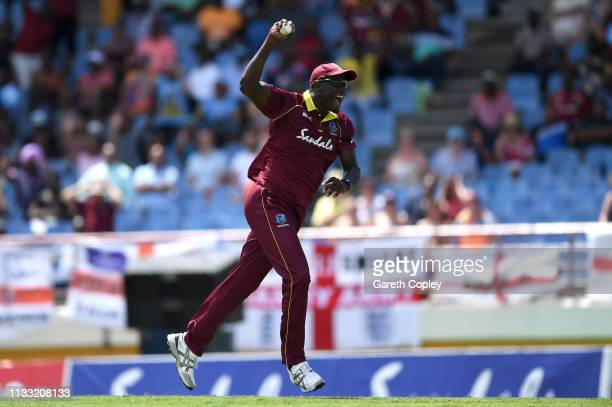 Carlos Brathwaite of the West Indies celebrates catching out Chris Woakes of England during the Fifth One Day International match between England and...