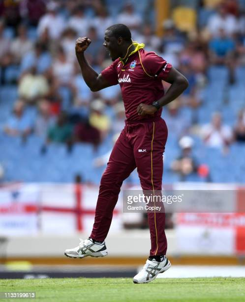 Carlos Brathwaite of the West Indies celebrates dismissing Alex Hales of England during the Fifth One Day International match between England and...
