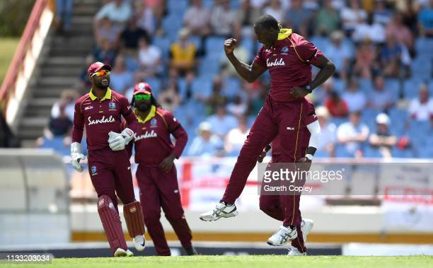 Carlos Brathwaite of the West Indies celebrates dismissing Ben Stokes of England during the Fifth One Day International match between England and...