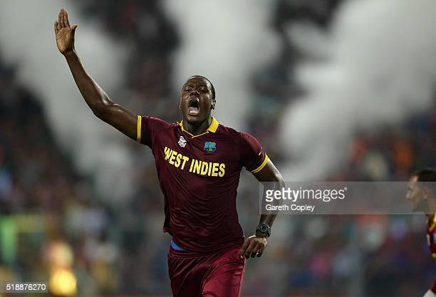 Carlos Brathwaite of the West Indies celebrates dismissing Joe Root of England during the ICC World Twenty20 India 2016 Final between England and the...