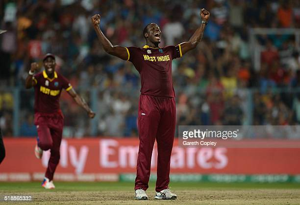 Carlos Brathwaite of the West Indies celebrates dismissing Jos Buttler of England during the ICC World Twenty20 India 2016 Final between England and...