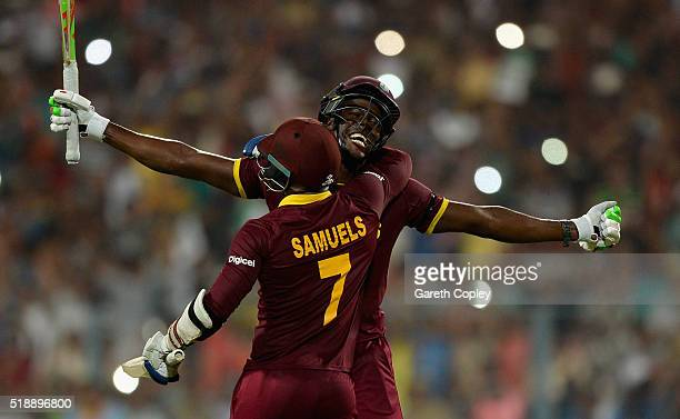 Carlos Brathwaite of the West Indies celebrates hitting the winning runs with Marlon Samuels to win the ICC World Twenty20 India 2016 Final between...