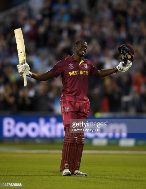 Carlos Brathwaite of the West Indies celebrates reaching his century during the Group Stage match of the ICC Cricket World Cup 2019 between West...