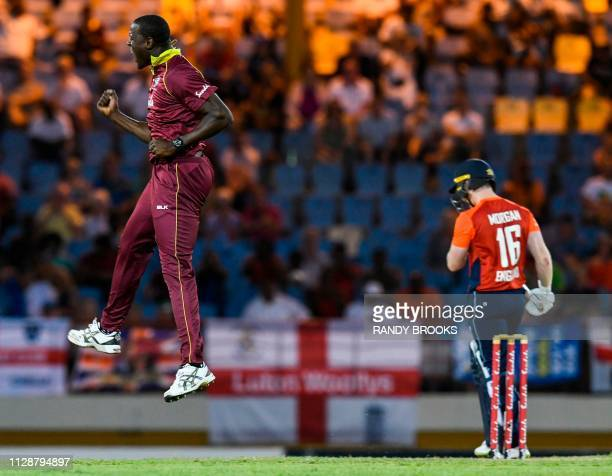 Carlos Brathwaite of the West Indies celebrates the dismissal of Eoin Morgan of England during a T20 match between the West Indies and England at...