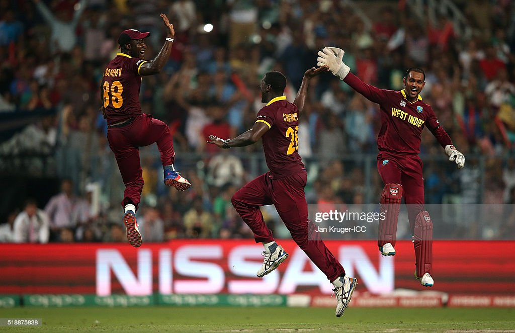 Carlos Brathwaite of the West Indies celebrates the wicket of Joe Root of England with Darren Sammy, Captain of the West Indies and Denesh Ramdin during the ICC World Twenty20 India 2016 final match between England and West Indies at Eden Gardens on April 3, 2016 in Kolkata, India.