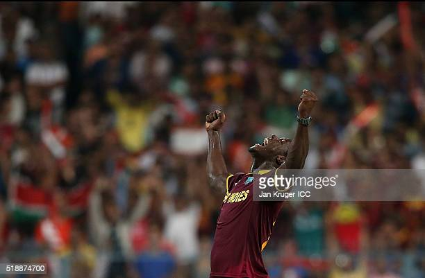 Carlos Brathwaite of the West Indies celebrates the wicket of Jos Buttler of England during the ICC World Twenty20 India 2016 final match between...