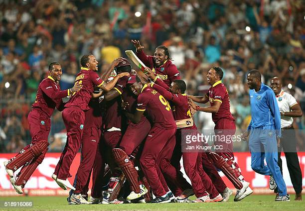 Carlos Brathwaite of the West Indies celebrates the winning runs with team mates during the ICC World Twenty20 India 2016 final match between England...
