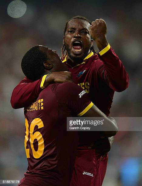 Carlos Brathwaite of the West Indies celebrates with Chris Gayle of the West Indies after dismissing Joe Root of England during the ICC World...