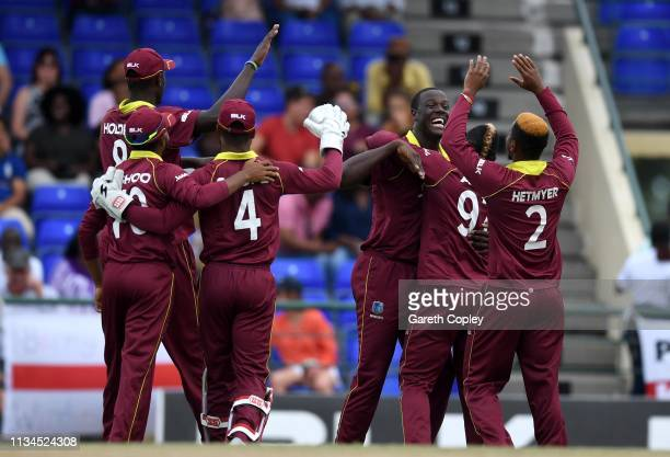 Carlos Brathwaite of the West Indies celebrates with teammates after dismissing England Eoin Morgan during the 2nd Twenty20 International match...