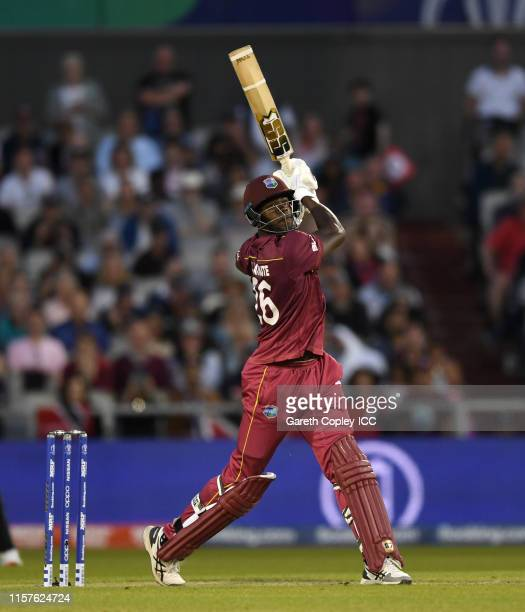 Carlos Brathwaite of the West Indies hits out for six runs during the Group Stage match of the ICC Cricket World Cup 2019 between West Indies and New...