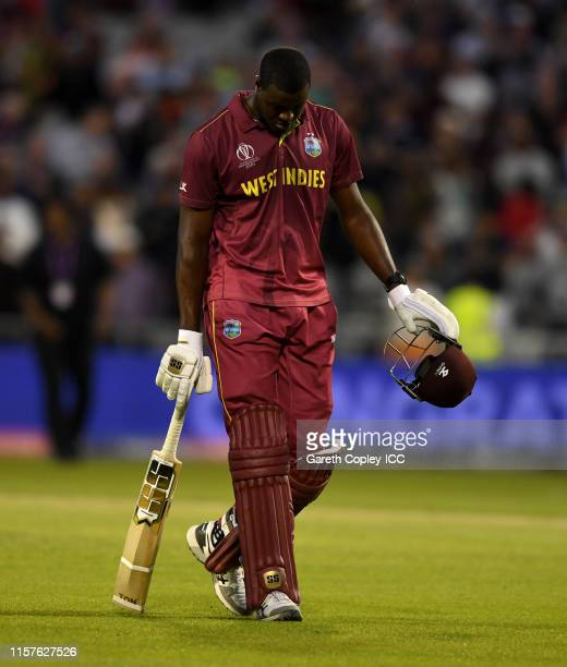 Carlos Brathwaite of the West Indies leaves the field after losing the Group Stage match of the ICC Cricket World Cup 2019 between West Indies and...
