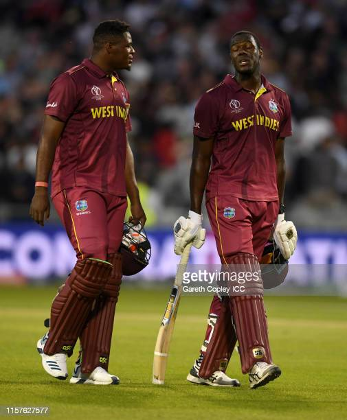 Carlos Brathwaite of the West Indies leaves the field with Oshane Thomas after losing the Group Stage match of the ICC Cricket World Cup 2019 between...