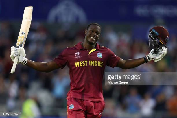 Carlos Brathwaite of West Indies celebrates reaching his century during the Group Stage match of the ICC Cricket World Cup 2019 between West Indies...