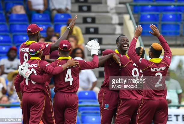 Carlos Brathwaite of West Indies celebrates the dismissal of Eoin Morgan of England during the 2nd T20I between West Indies England at Warner Park,...