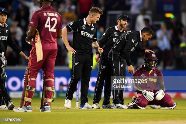Carlos Brathwaite of West Indies is consoled as he is caught on the boundary and West Indies lose the match during the Group Stage match of the ICC...