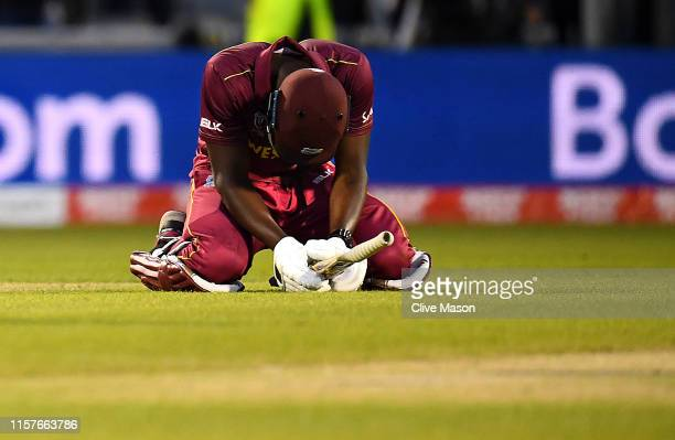 Carlos Brathwaite of West Indies looks dejected as West Indies lose the match during the Group Stage match of the ICC Cricket World Cup 2019 between...