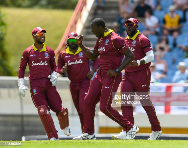 Carlos Brathwaite Shai Hope Chris Gayle and Ashley Nurse of West Indies celebrate the dismissal of Ben Stokes of England during the 5th and final ODI...