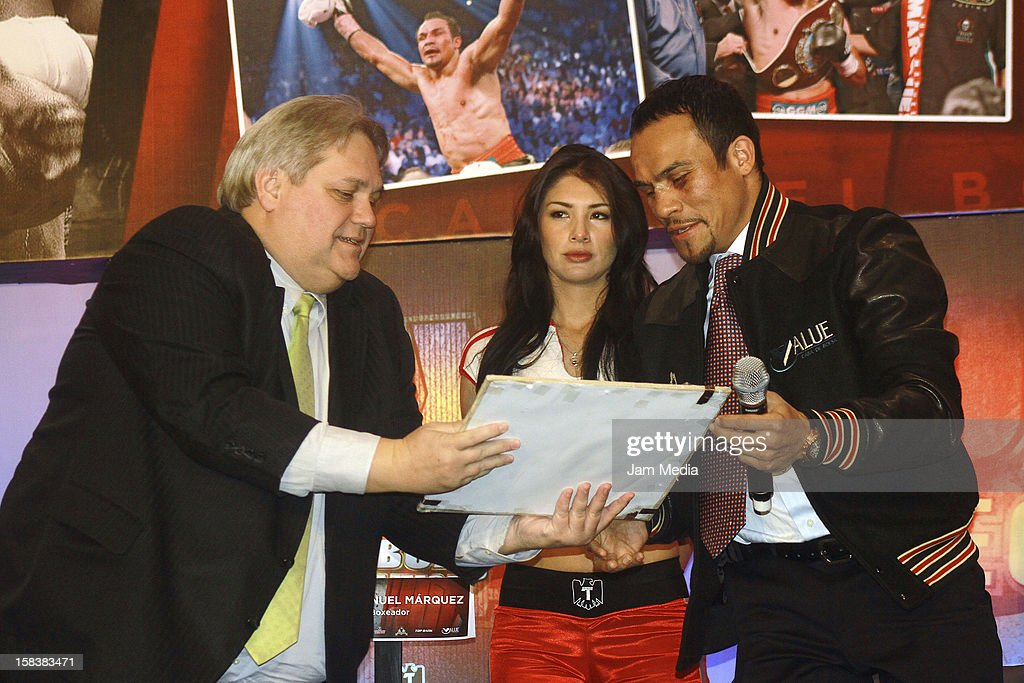 Carlos Bremer and Boxer Juan Manuel Marquez, during a press conference after the fight between Manny Pacquiao and Juan Manuel Marquez at Presidente Intercontinental Hotel on December 14, 2012 in Mexico City, Mexico.