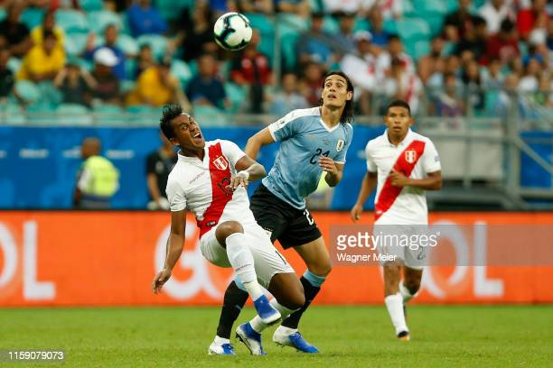 Carlos Caceda of Peru fights for the ball with Edinson Cavani of Uruguay during the Copa America Brazil 2019 quarterfinal match between Uruguay and...