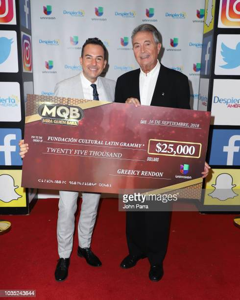 Carlos Calderon and VP of Latin GRAMMY Cultural Foundation Manolo Diaz receive check from Mira Quien Baila Winner Greeicy Rendon for Latin GRAMMY...