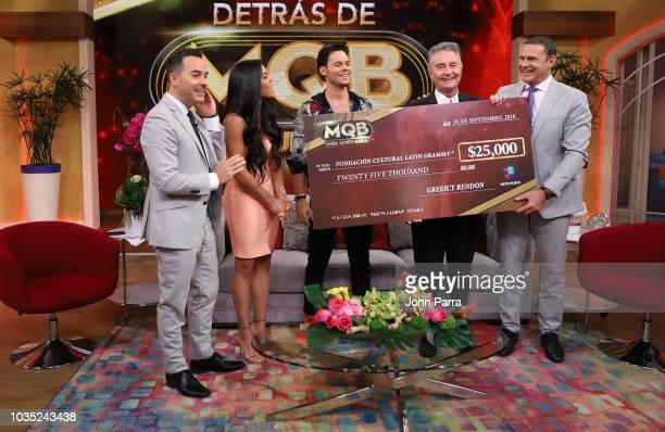 Carlos Calderon, Francisca Lachapel, Emmanuel Palomares, Manolo Diaz and Alan Tacher receive check from Mira Quien Baila Winner Greeicy Rendon on...
