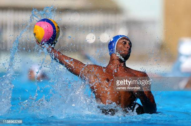 Carlos Camnasio of Argentina attempts a shot at the net during the 2019 FINA World League InterContinental Cup Men's match between Japan and...
