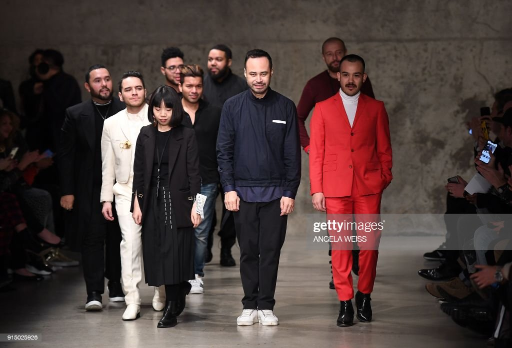 Carlos Campos (C) and his creative team walk the runway during New York Fashion Week Mens' at Skylight Modern on February 6, 2018 in New York City. /