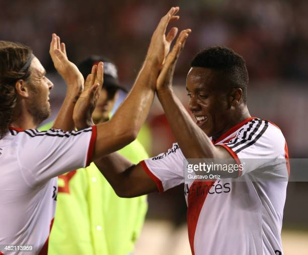 Carlos Carbonero and Fernando Cavenaghi of River Plate celebrate a scored goal during a match between River Plate and Newell's as part of 11th round...