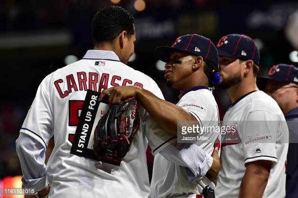 Carlos Carrasco and Francisco Lindor of the Cleveland Indians participate in the Stand Up To Cancer during the 2019 MLB All-Star Game at Progressive...