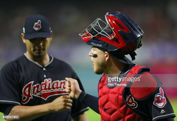 Carlos Carrasco and Roberto Perez of the Cleveland Indians celebrate after leaving a runner stranded at the end of the first inning of the game...
