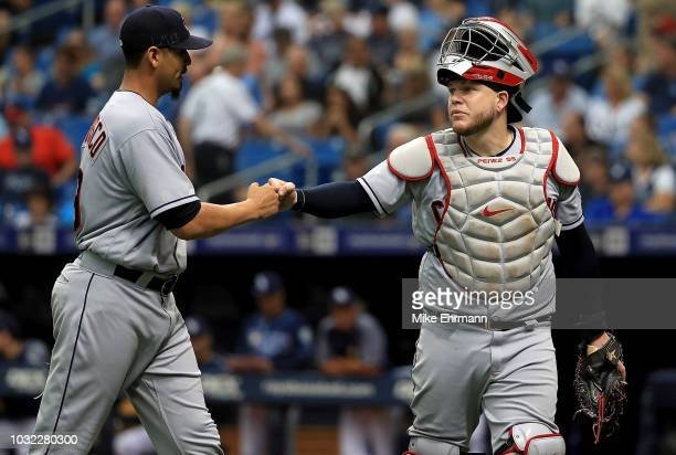 Carlos Carrasco and Roberto Perez of the Cleveland Indians high five during a game against the Tampa Bay Rays at Tropicana Field on September 12 2018...