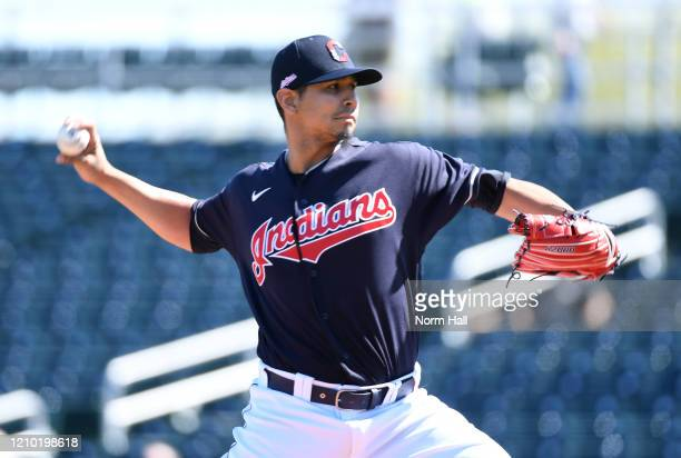 Carlos Carrasco of the Cleveland Indians delivers a first inning pitch against the Los Angeles Angels during a spring training game at Goodyear...
