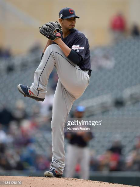 Carlos Carrasco of the Cleveland Indians delivers a pitch against the Minnesota Twins during the first inning of the game on March 31, 2019 at Target...