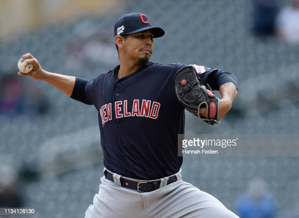 Carlos Carrasco of the Cleveland Indians delivers a pitch against the Minnesota Twins during the first inning of the game on March 31 2019 at Target...