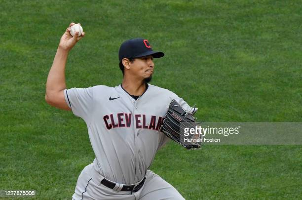 Carlos Carrasco of the Cleveland Indians delivers a pitch against the Minnesota Twins during the first inning of the game at Target Field on August...
