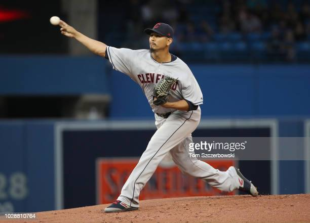 Carlos Carrasco of the Cleveland Indians delivers a pitch in the first inning during MLB game action against the Toronto Blue Jays at Rogers Centre...