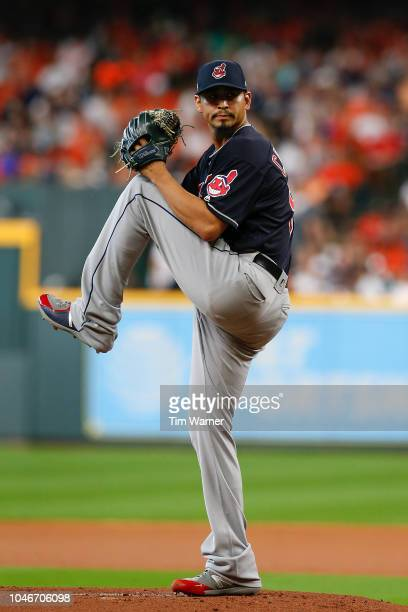 Carlos Carrasco of the Cleveland Indians delivers a pitch in the first inning against the Houston Astros during Game Two of the American League...