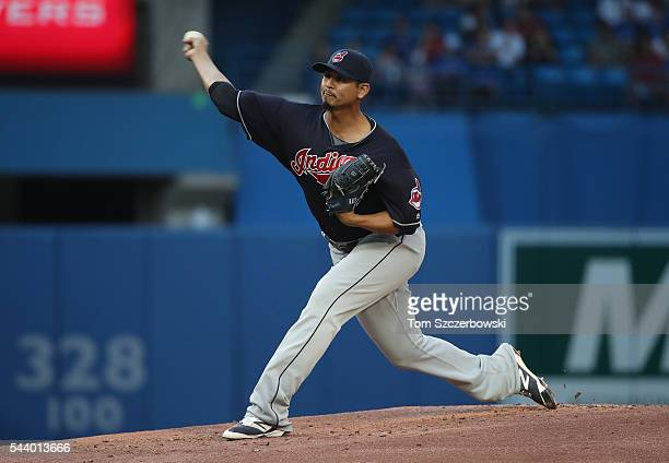 Carlos Carrasco of the Cleveland Indians delivers a pitch in the first inning during MLB game action against the Toronto Blue Jays on June 30 2016 at...