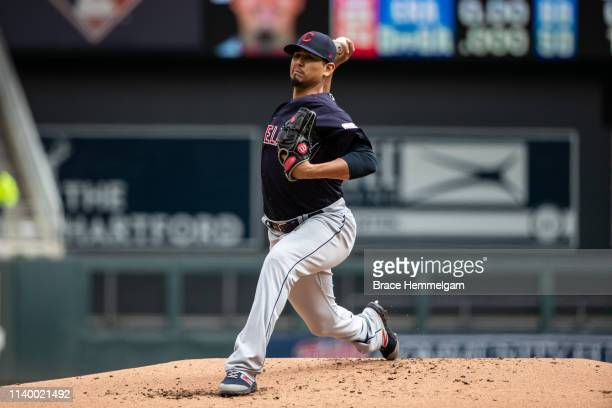 Carlos Carrasco of the Cleveland Indians pitches against the Minnesota Twins on March 31 2019 at the Target Field in Minneapolis Minnesota The Twins...