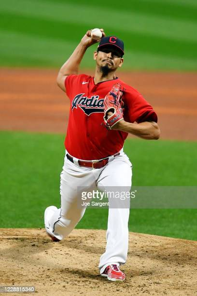 Carlos Carrasco of the Cleveland Indians pitches during Game 2 of the Wild Card Series between the New York Yankees and the Cleveland Indians at...