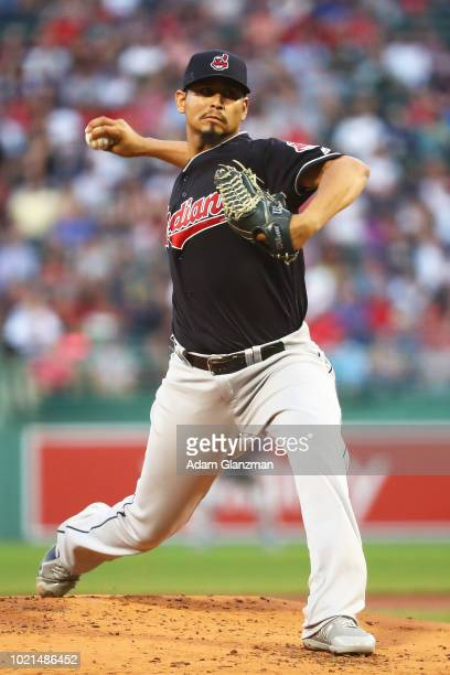 Carlos Carrasco of the Cleveland Indians pitches in the first inning of a game against the Boston Red Sox at Fenway Park on August 22 2018 in Boston...