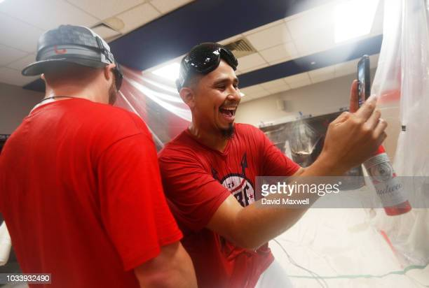 Carlos Carrasco of the Cleveland Indians takes a selfie with teammate Jason Kipnis during a locker room celebration after the Indians defeated the...