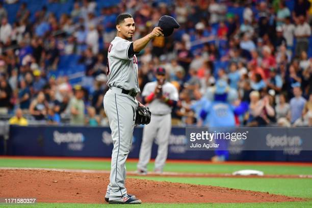 Carlos Carrasco of the Cleveland Indians tips hit hat to manager Terry Francona before the seventh inning during action against the Tampa Bay Rays at...