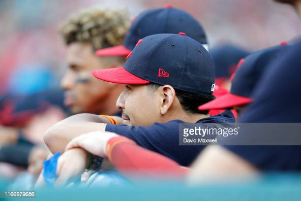 Carlos Carrasco of the Cleveland Indians watches from the dugout against the Los Angeles Angels of Anaheim in the first inning at Progressive Field...