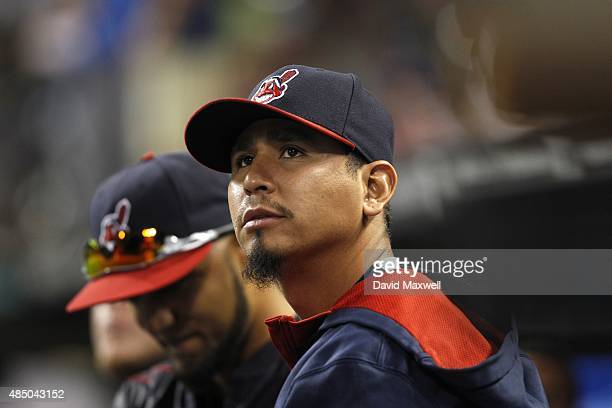 Carlos Carrasco of the Cleveland Indians watches from the dugout against the New York Yankees during the eighth inning on August 13 2015 at...