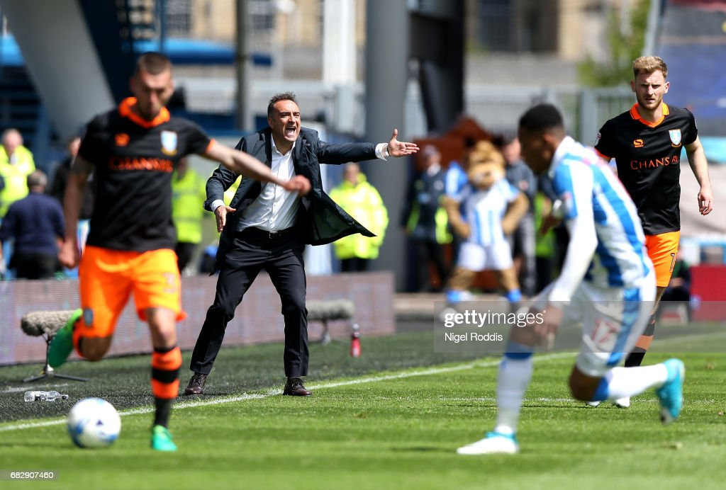 Carlos Carvalhal, Manager of Sheffield Wednesday gives his team instructions during the Sky Bet Championship Play Off Semi Final 1st leg match between Huddersfield Town and Sheffield Wednesday at Galpharm Stadium on May 14, 2017 in Huddersfield, England.
