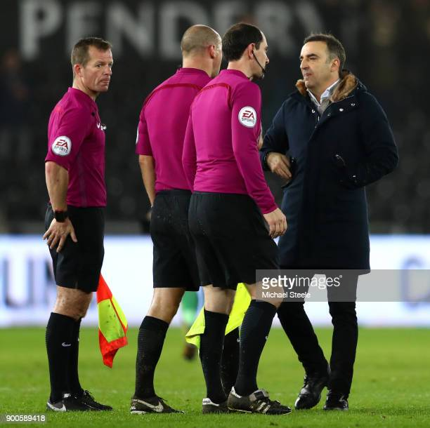 Carlos Carvalhal Manager of Swansea City argues with referee Bobby Madley after the Premier League match between Swansea City and Tottenham Hotspur...