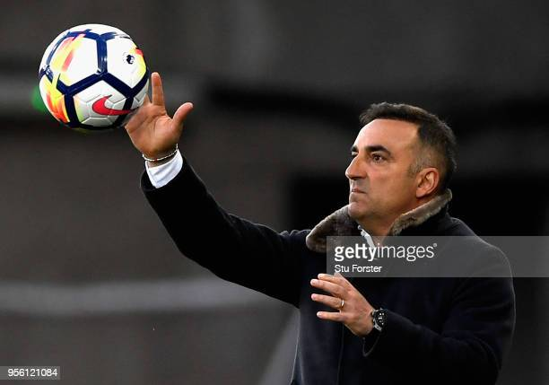 Carlos Carvalhal Manager of Swansea City catches the ball during the Premier League match between Swansea City and Southampton at Liberty Stadium on...