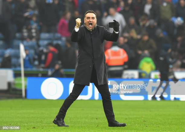 Carlos Carvalhal Manager of Swansea City celebrates at the end of the Premier League match between Huddersfield Town and Swansea City at John Smith's...